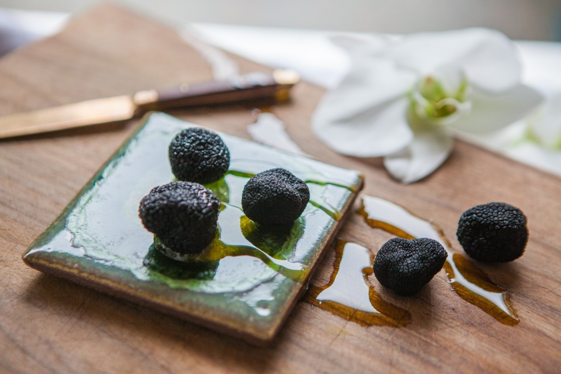 black truffles, olive oil and orchids